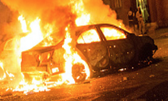 When an elderly couple's car caught fire, they were trapped —until two strangers stepped in