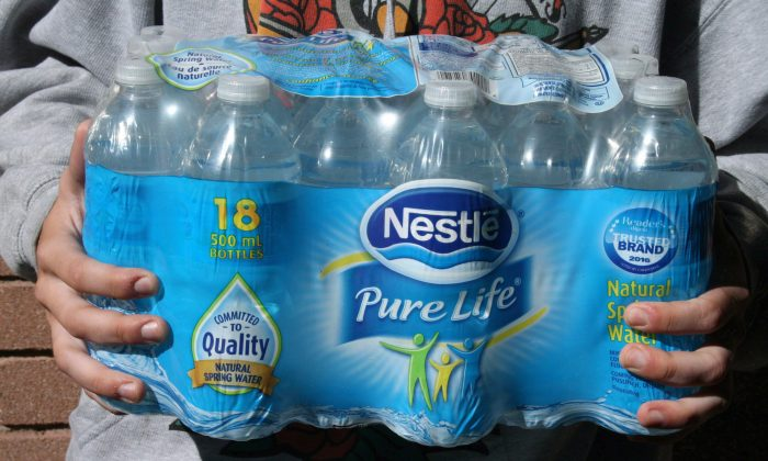 Activists are planning to step up protests over government policy that allows Nestlé Waters Canada to extract more than a billion litres of water on expired permits in rural Ontario. (The Canadian Press/Richard Buchan)
