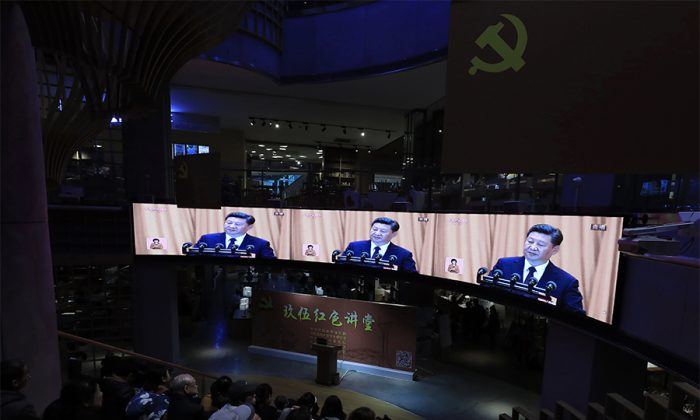 War veterans and local residents watch Chinese leader Xi Jinping give an address at the 19th National Congress on television, at a bookstore in Shenyang City in China's northeastern Liaoning Province on October 18, 2017.(STR/AFP/Getty Images)