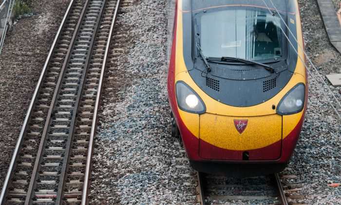 A Virgin train arrives at Euston station in London in this file photo. A 15-year-old girl was 'stranded' after rail staff refused to believe she was under 16. (Will Oliver/AFP/GettyImages)