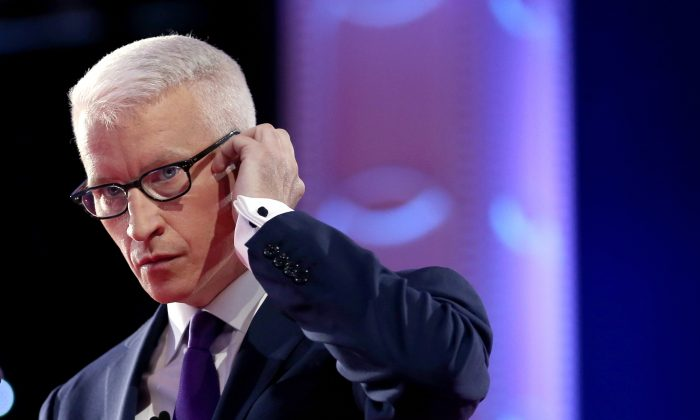 CNN anchor Anderson Cooper adjusts his earpiece during a commercial break while moderating a Democratic presidential debate sponsored by CNN at Wynn Las Vegas on Oct. 13, 2015. (Joe Raedle/Getty Images)