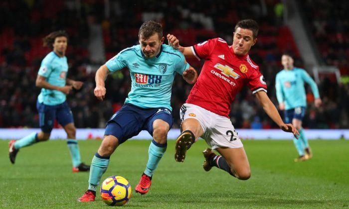 Ryan Fraser of AFC Bournemouth is tackled by Ander Herrera of Manchester United during the Premier League match between Manchester United and AFC Bournemouth at Old Trafford on Dec 13, 2017 in Manchester, England. (Catherine Ivill/Getty Images)