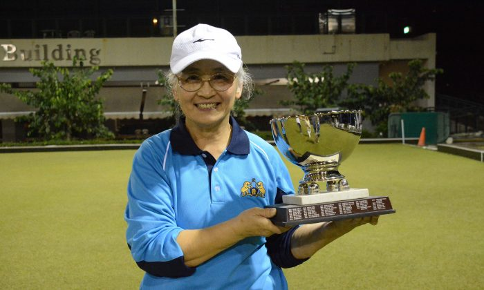 Shirley Ko of Indian Recreation Club proudly displays her Women's Knockout Singles trophy after defeating Gloria Ha from the Hong Kong Youth Team on Sunday evening Dec 10, 2017. (Stephanie Worth)