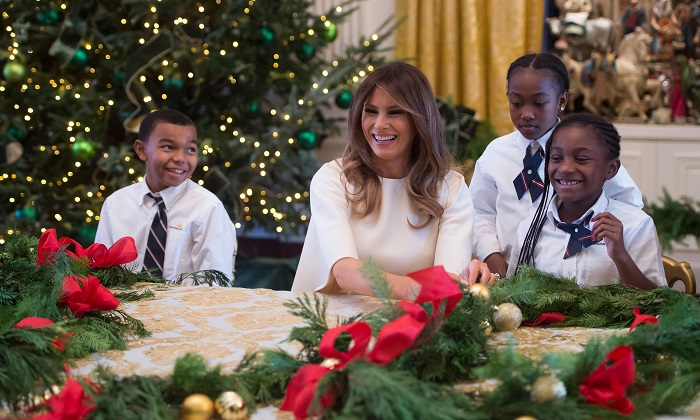 First Lady Melania Trump makes Christmas decorations with children in the State Dining Room as she tours holiday decorations at the White House in Washington, DC, Nov. 27, 2017. (Saul Loeb/AFP/Getty Images)