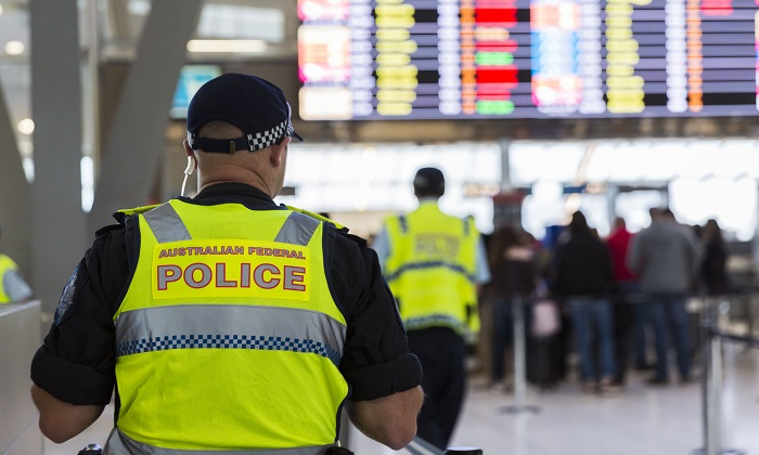 Australian Federal Police Officers patrol Sydney Airport on July 30, 2017. (Brook Mitchell/Getty Images)