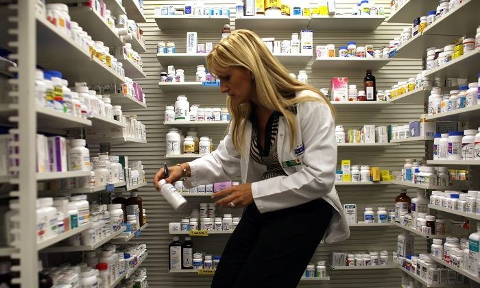 A pharmacy manager retrieves a from the shelf, in Miami, Florida in this file photo. (Joe Raedle/Getty Images)