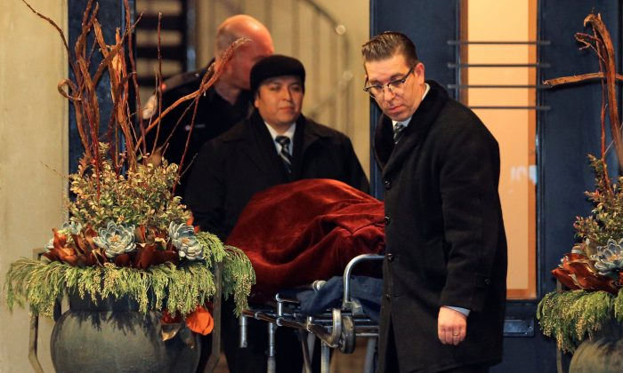 "One of two bodies is removed from the home of billionaire founder of Canadian pharmaceutical firm Apotex Inc., Barry Sherman and his wife Honey, who were found dead under circumstances that police described as ""suspicious"" in Toronto, Ontario, Canada, Dec. 15, 2017. (Reuters/Chris Helgren)"
