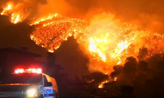 Thomas wildfire burns above Bella Vista Drive near Romero Canyon in this social media photo by Santa Barbara County Fire Department in Montecito, California, Dec. 12, 2017. (Mike Eliason/Santa Barbara County Fire Department/Handout via Reuters)