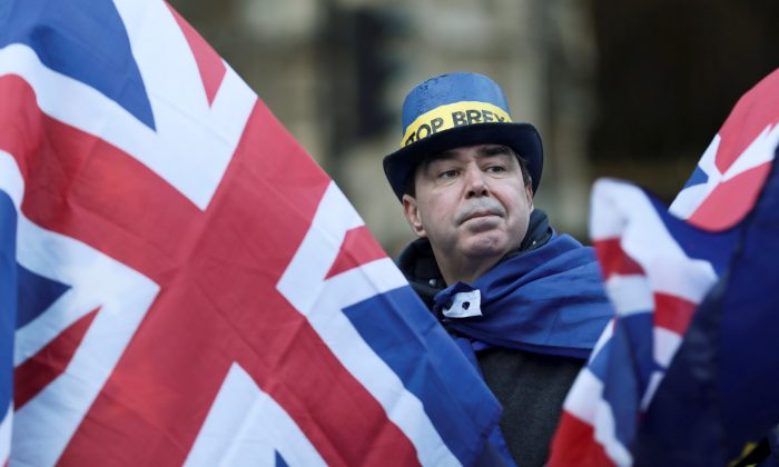 An anti-Brexit protester demonstrates outside the Houses of Parliament in London, Britain, on Dec. 13, 2017. (Reuters/Simon Dawson)