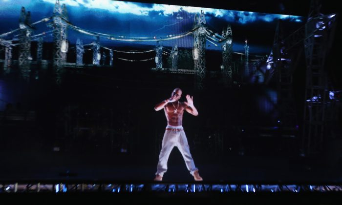 A hologram of deceased rapper Tupac Shakur performs onstage during day 3 of the 2012 Coachella Valley Music & Arts Festival at the Empire Polo Field in Indio, Calif., on April 15, 2012. (Christopher Polk/Getty Images for Coachella)