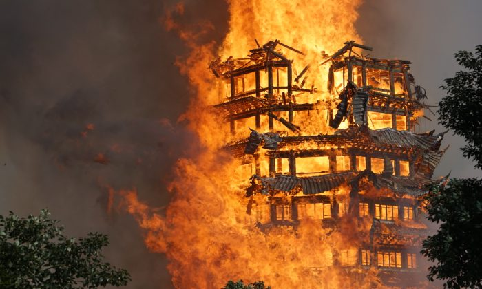 Fire engulfs a 16-story wooden pagoda at Jiulong Town in Deyang, Sichuan Province of China on Dec. 10, 2017. A huge blaze has engulfed and destroyed a 16-story wooden tower, known as the tallest of its kind in Asia, after a fire, starting at the Lingguan Mansion, raged through a monastery in Sichuan Province, southwest China. (VCG/VCG via Getty Images)