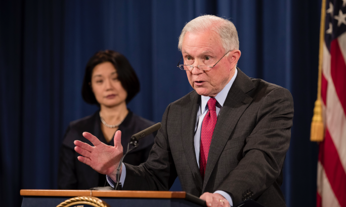Attorney General Jeff Sessions (R) and U.S. Attorney Jessie K. Liu for the District of Columbia at a press conference at the Justice Department in Washington on Dec. 15, 2017. (Samira Bouaou/The Epoch Times)