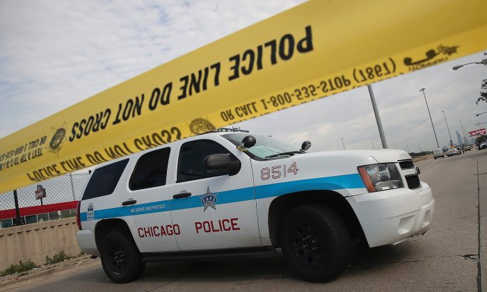 Police investigate the murder of a young man found shot to death in Chicago, Illinois on June 30, 2017. (Scott Olson/Getty Images)