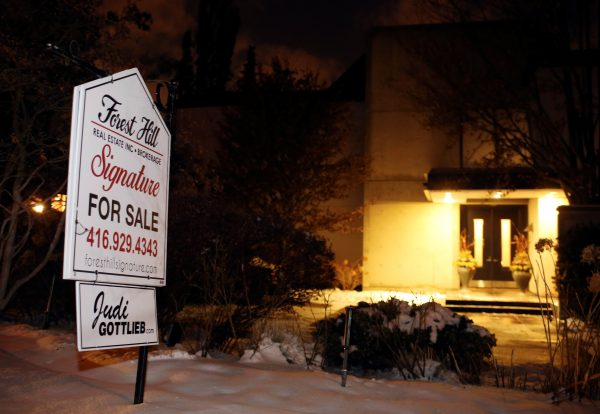 """A For Sale sign stands outside the home of billionaire founder of Canadian pharmaceutical firm Apotex Inc. Barry Sherman and his wife Honey were found dead under circumstances that police described as """"suspicious"""" in Toronto on Dec. 15, 2017. (Reuters/Chris Helgren)"""