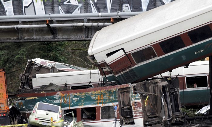 The scene where an Amtrak passenger train derailed on a bridge over interstate highway I-5  in DuPont, Washington, U.S. December 18, 2017. (REUTERS/Steve Dipaola)