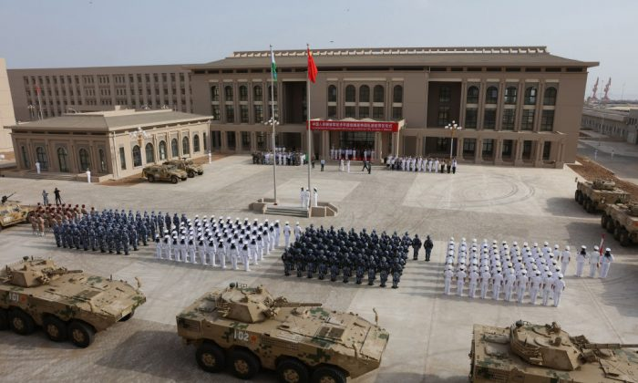 The Chinese regime's People's Liberation Army holds an opening ceremony of China's new military base in the African nation of Djibouti on Aug. 1. (STR/AFP/Getty Images)