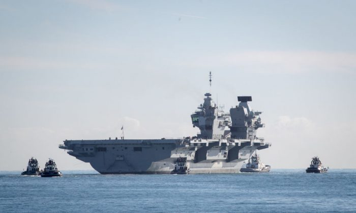 The Royal Navy's newest aircraft carrier HMS Queen Elizabeth departs Portmouth dockyard on Oct. 30, 2017 in Portsmouth, England. (Matt Cardy/Getty Images)