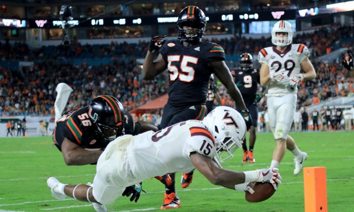 Sean Savoy No. 15 of the Virginia Tech Hokies dives for the pylon during a game against the Miami Hurricanes at the Hard Rock Stadium on Nov. 4, 2017, in Miami Gardens, Fla. (Mike Ehrmann/Getty Images)