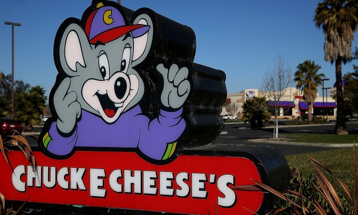 Chuck E. Cheese: Where a Kid Can Be a Kid, and on occasion, and adult can act like an idiot. (Justin Sullivan/Getty Images)