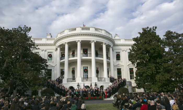 President Donald Trump celebrates the passage of the tax bill, while flanked by  Republican members of Congress, on the South Lawn of the White House in Washington, Dec. 20, 2017. (Samira Bouaou/The Epoch Times)