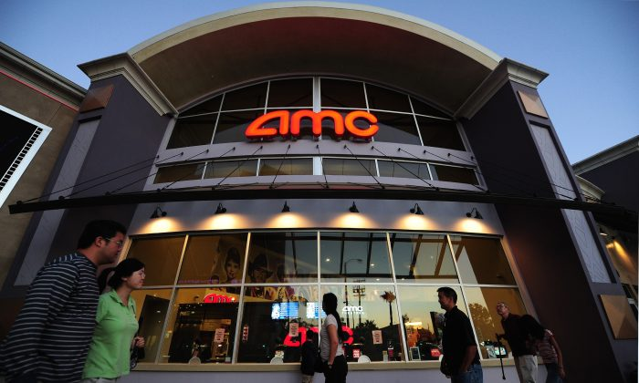 People walk past movie theaters of the U.S. cinema chain AMC Theatres in Monterey Park, east of downtown Los Angeles, California, on May 22, 2012. (Frederic J. Brown/AFP/Getty Images)