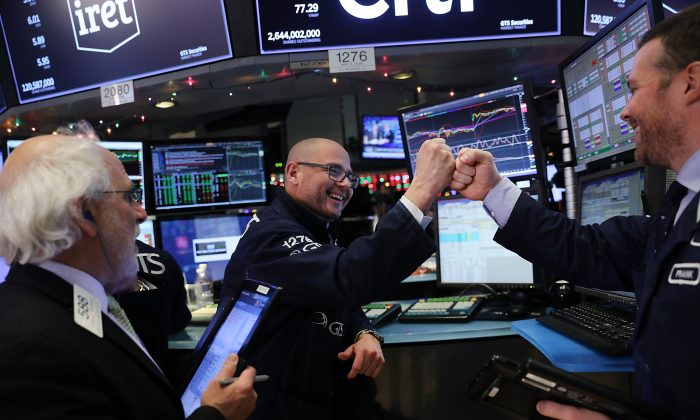 Traders work on the floor of the New York Stock Exchange at the end of the trading day on Dec. 4. 2017 has seen 70 new record highs in the stock market, the most ever. (Spencer Platt/Getty Images)