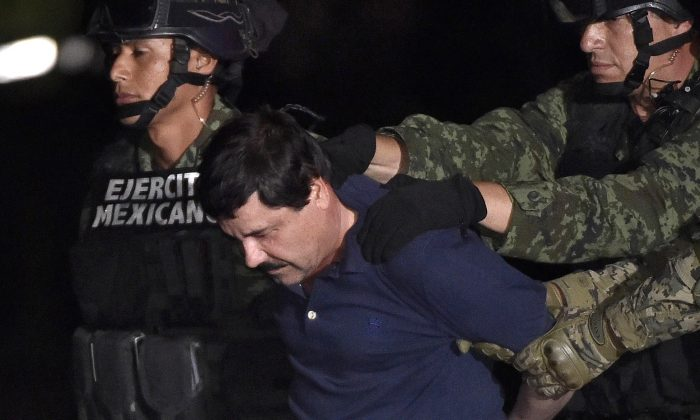 Drug kingpin Joaquin 'El Chapo' Guzman is escorted into a helicopter at Mexico City's airport on January 8, 2016 following his recapture during an intense military operation in Los Mochis, in Sinaloa State. (Omar Torres/AFP/Getty Images)