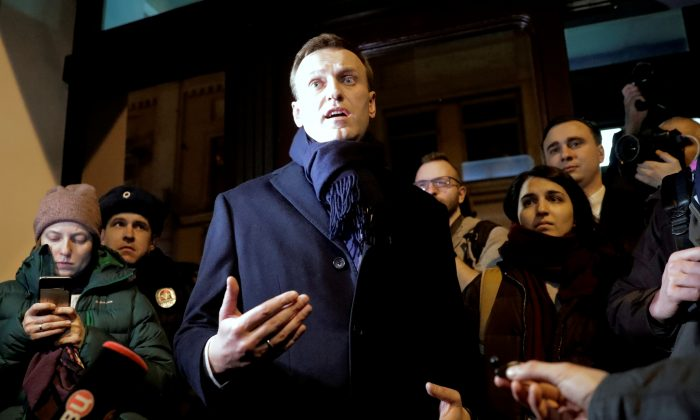 Russian opposition leader Alexei Navalny speaks to the media after submitting his documents to be registered as a presidential candidate at the Central Election Commission in Moscow, Russia, on Dec. 24, 2017. (REUTERS/Tatyana Makeyeva)