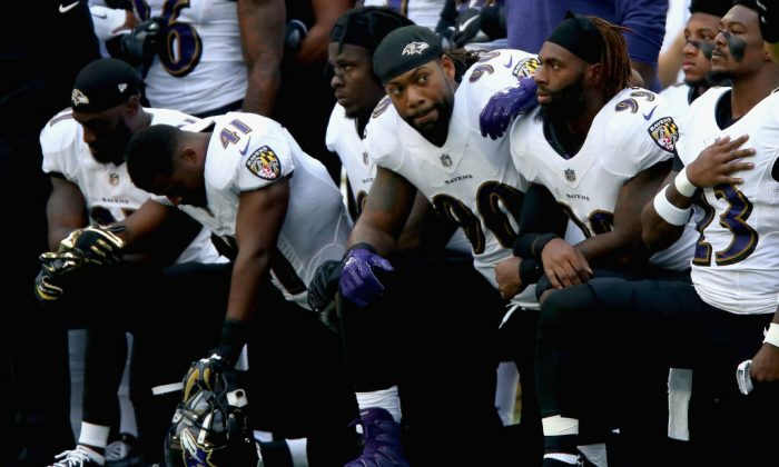 Baltimore Ravens players kneel for the American National anthem during the NFL International Series match between the Baltimore Ravens and Jacksonville Jaguars at Wembley Stadium on Sept. 24, 2017 in London, England.  (Photo by Alex Pantling/Getty Images)
