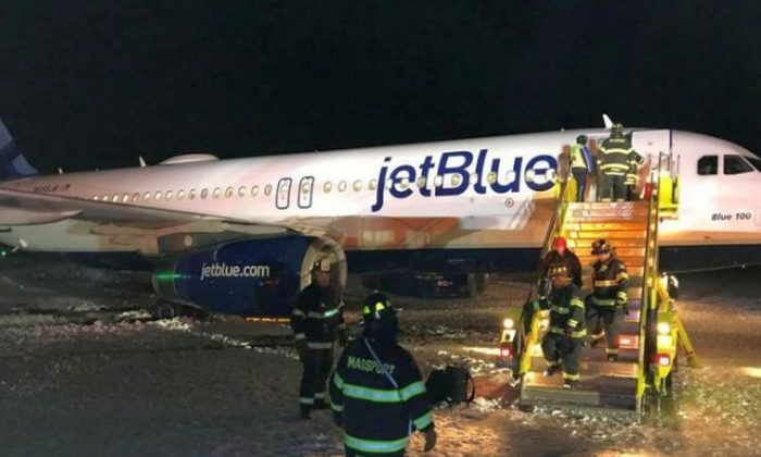 A JetBlue plane is seen at the Boston's Logan International Airport in Boston, Massachusetts, U.S., December 25, 2017 in this picture obtained from social media. Picture taken December 25, 2017. Yuval Gonczarowski/via REUTERS