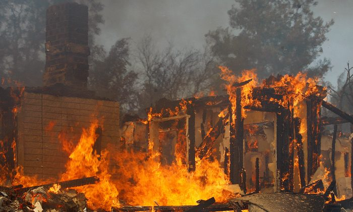 A house burns in San Marcos, California on May 15, 2014. (David McNew/Getty Images)