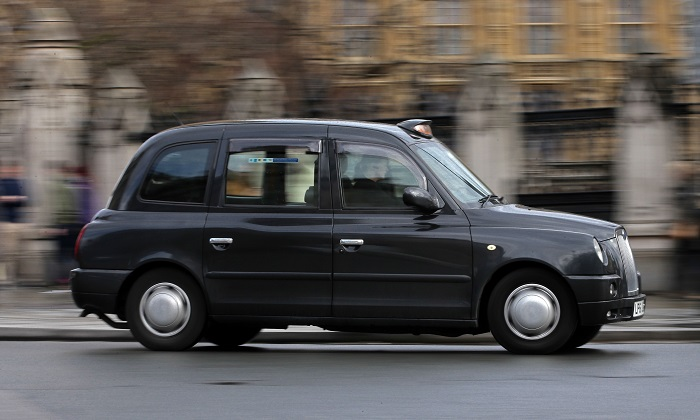 A London taxi travels past the Houses of Parliament. A taxi driver who helped people flee the London Bridge terror attack on June 3 has now been hit with a £270 bill (US $363) for jumping a red light as they fled the scene. (Daniel Leal-Olivas/AFP/Getty Images)