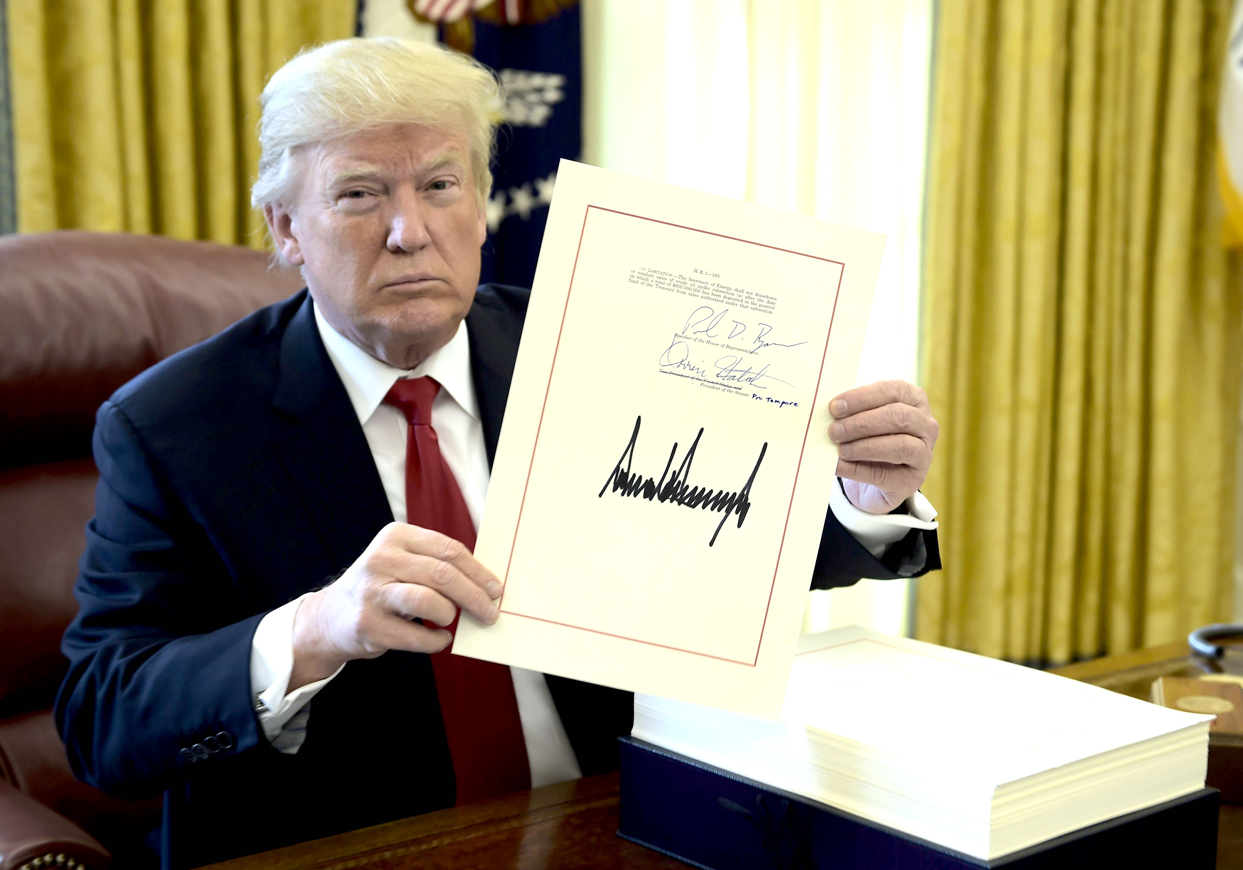 President Donald Trump during the signing event for the Tax Cut and Reform  Bill, in the Oval Office at the White House in Washington on Dec. 22, 2017.