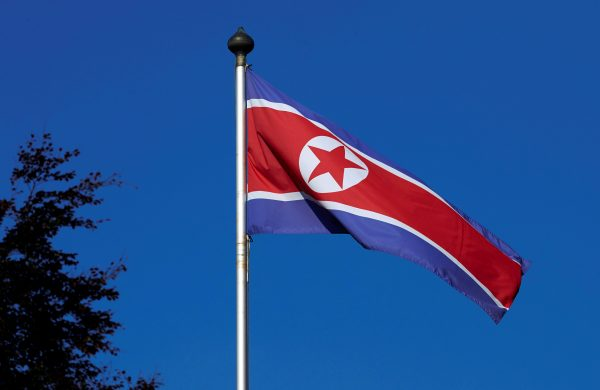 A North Korean flag flies on a mast at the Permanent Mission of North Korea in Geneva on Oct. 2 2014
