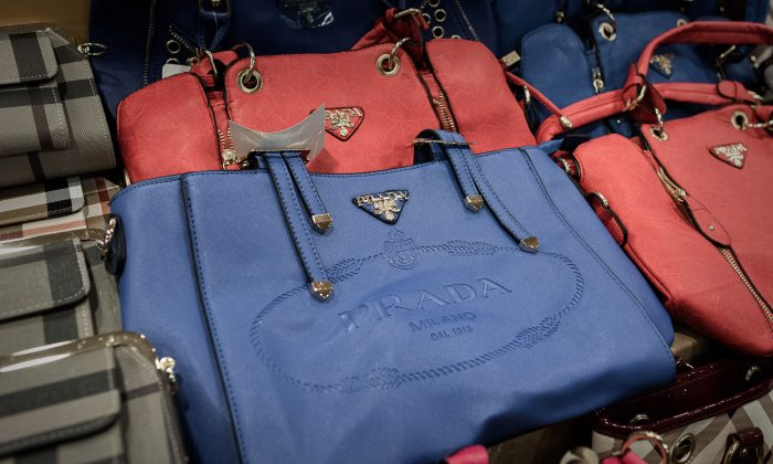 Counterfeit Prada handbags are displayed at a press conference following a record seizure at the customs headquarters in Hong Kong on August 6, 2015.    (Philippe Lopez/AFP/Getty Images)