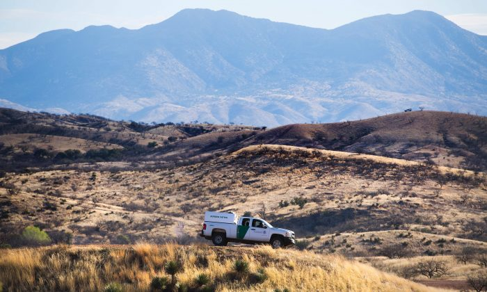 A Border Patrol agent parks on a hilltop near the border fence in Nogales, Arizona, on Feb. 17, 2017. A high-speed chase near Amado, Arizona, resulted in several charges against a man, including for smuggling aliens and shooting at Border Patrol agents on Dec. 24, 2017. (JIM WATSON/AFP/Getty Images)