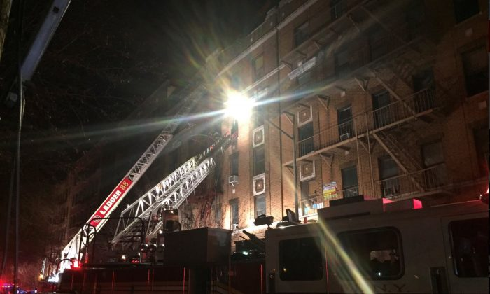 New York Fire Department ladder trucks deploy at a building fire in the Bronx borough of New York City, New York, U.S. December 28, 2017.  (NYFD/Handout via REUTERS)