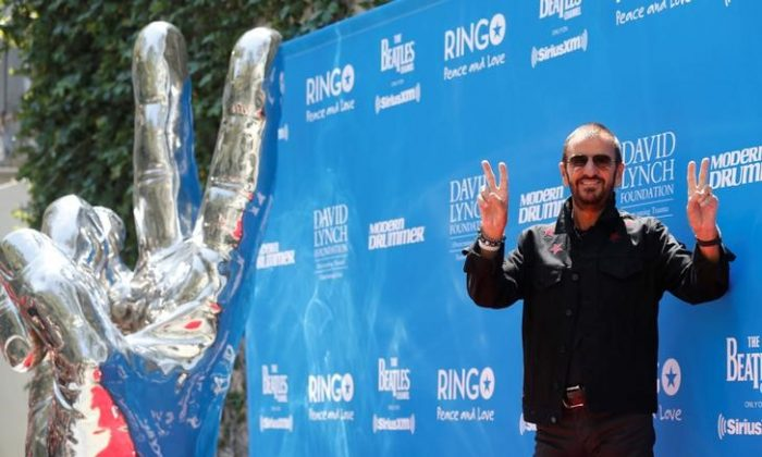"Musician Ringo Starr poses during a ""Peace & Love"" event to celebrate Starr's 77th birthday in Los Angeles, California, U.S., July 7, 2017. (Reuters/Mario Anzuoni)"