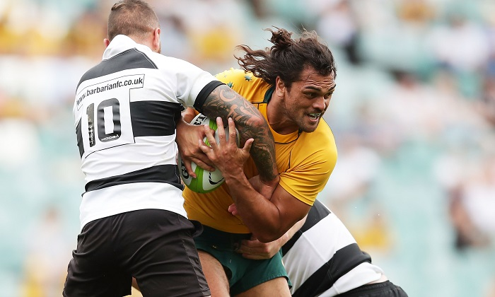 Karmichael Hunt of the Wallabies is tackled during the match between the Australian Wallabies and the Barbarians at Allianz Stadium on Oct. 28, 2017 in Sydney. (Matt King/Getty Images)