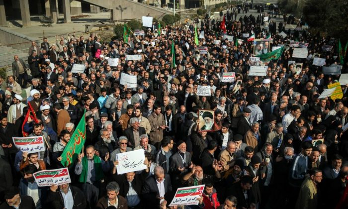 Iranians chant slogans as they march in support of the government near the Imam Khomeini grand mosque in the capital Tehran on Dec. 30, 2017. Tens of thousands of regime supporters marched in cities across Iran in a show of strength for the regime after two days of angry protests directed against the country's religious rulers. (Hamed Malekpour/AFP/Getty Images)