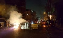 Protests hit Tehran, two demonstrators reported killed in Iran town