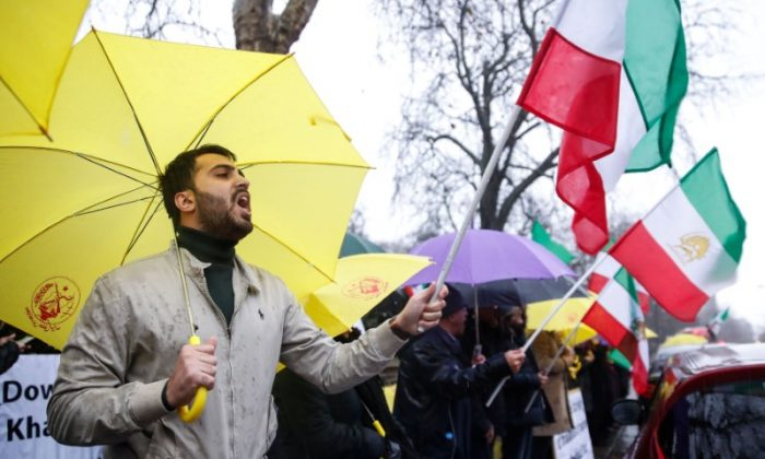 Opponents of Iranian President Hassan Rouhani hold a protest outside the Iranian embassy in west London, on Dec. 31, 2017. (REUTERS/Eddie Keogh)