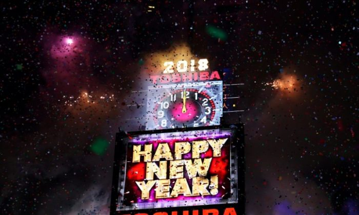 Fireworks go off in Times Square to celebrate the New Year in New York City, New York, Jan. 1, 2018. (Reuters/Carlo Allegri)
