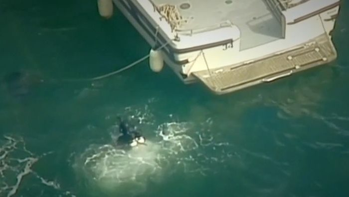 """A seaplane crashed into the Sydney River on Sunday,  Dec. 31, 2017, killing six people on a """"wine and dine"""" sightseeing flight ahead of the city's New Year's Eve celebrations at the harbor. (Reuters video screenshot)"""