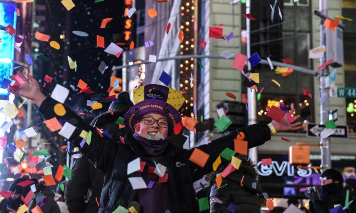 People throw confetti on New Year's Eve in Times Square on January 1, 2018 in New York City. (Stephanie Keith/Getty Images)