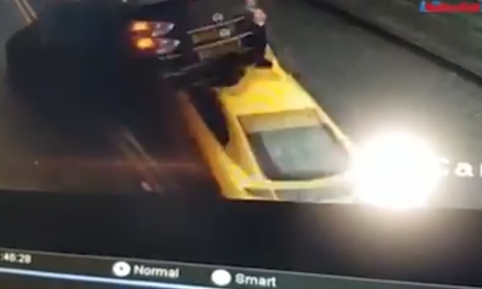 Shocking footage shows car flying into the air after being rammed by Audi R8 supercar in Bradford, UK, on New Year's Eve. (Screenshot via YouTube / OM PROD)