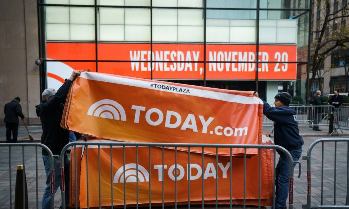 "Workers break down the outside portrait of the set of NBC's ""Today"" show, Nov. 29, 2017, in New York City. It was announced that long time ""Today"" show host Matt Lauer had been fired for sexual misconduct. (Drew Angerer/Getty Images)"