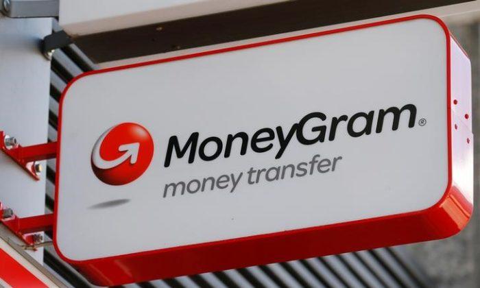 A Moneygram logo is seen outside a bank in Vienna, Austria, June 28, 2016. (Heinz-Peter Bader/Reuters)