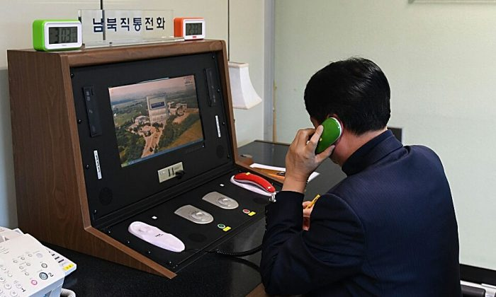 A South Korean government official checks the direct communications hotline to talk with the North Korean side at the border village of Panmunjom on Jan. 3, 2018 in Panmunjom, South Korea. (South Korean Unification Ministry via Getty Images)