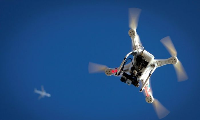 An airplane flies over a drone during the Polar Bear Plunge on Coney Island in the Brooklyn borough of New York, U.S., January 1, 2015. (Reuters/Carlo Allegri/File Photo)